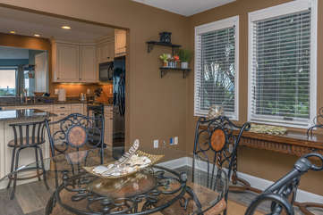The adjoining dining room makes serving meals easy.
