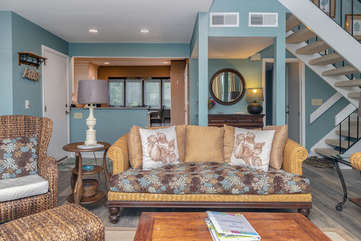 This great room has vaulted ceilings and a bright decor.