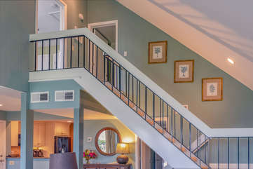 Take the stairs to the second level. You will find two additional bedrooms and a shared bath.