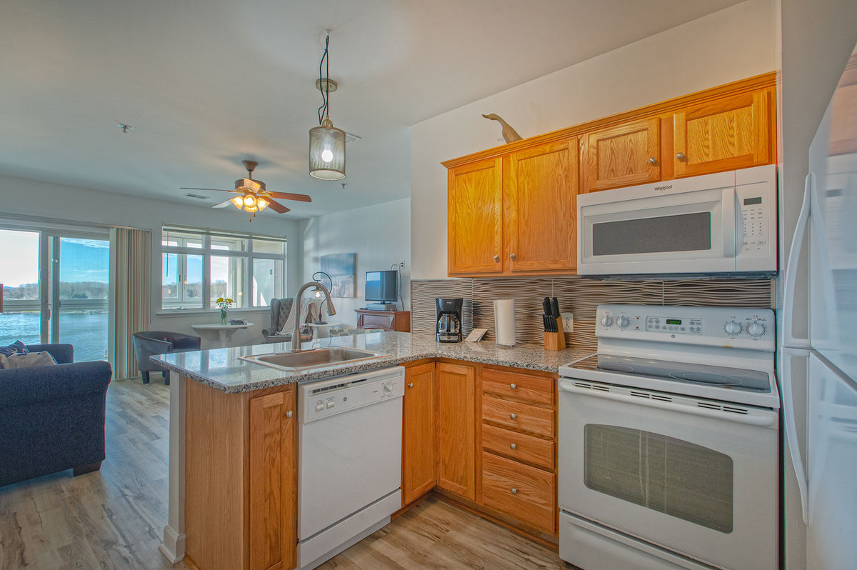 Kitchen with Microwave and Coffee Maker.