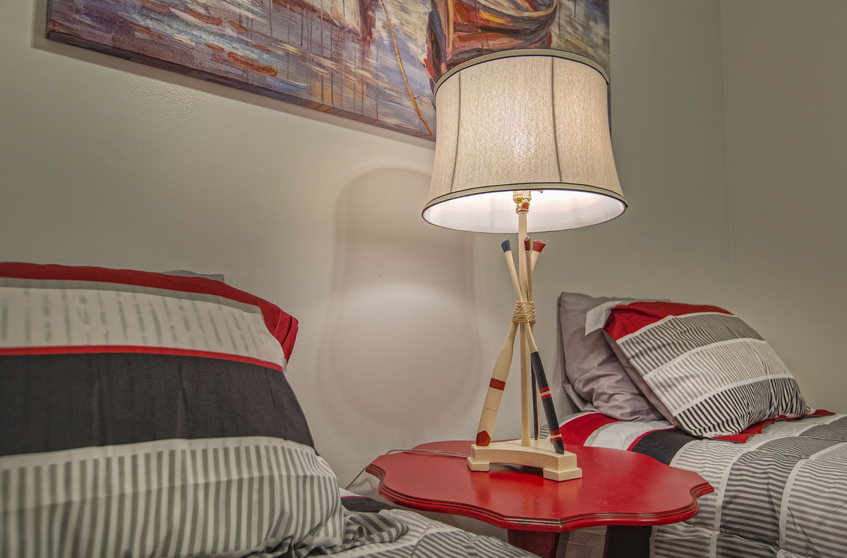 Nightstand, Table Lamp, and Twin Beds.