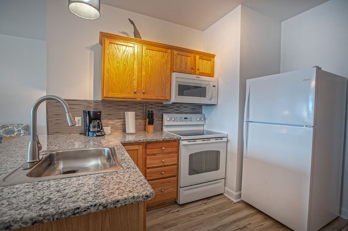 Kitchen with Microwave and Refrigerator.