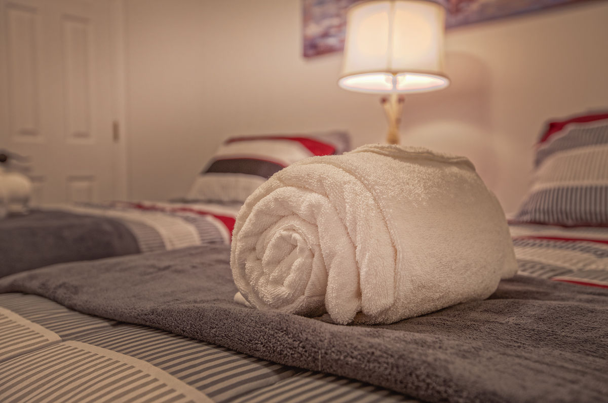 Twin Beds, Table Lamp, and Towel.