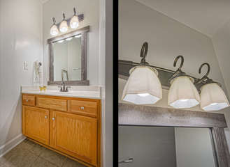 Single Vanity Sink, Mirror, and Wall Lamp.