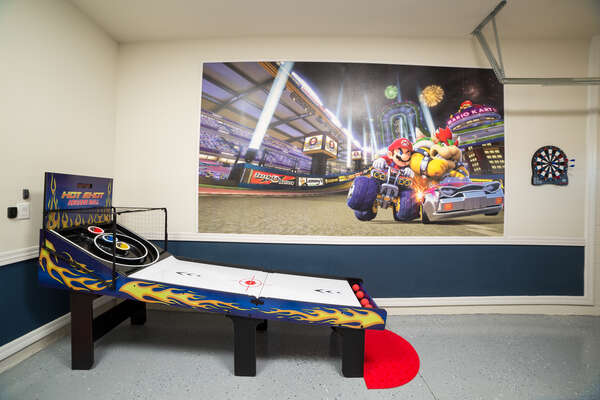 Shoot some darts or some balls in the game room