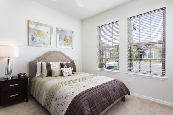 Sleep well after a long day in this downstairs queen bedroom