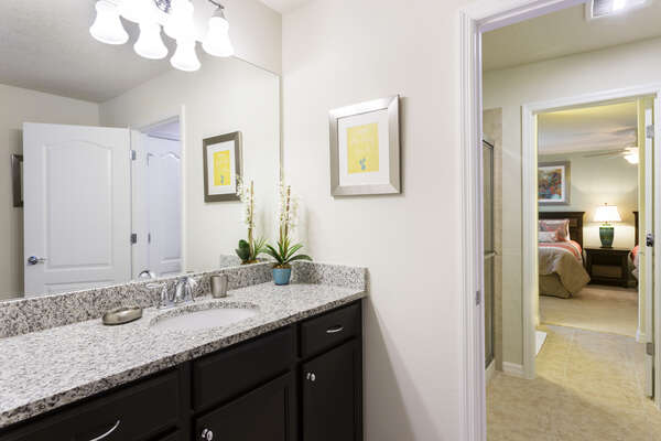 En suite Jack and Jill bathroom with walk-in shower