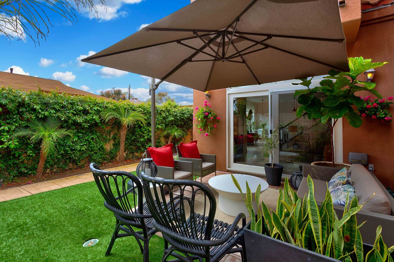 Umbrella covered patio with comfortable seating