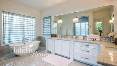 Custom luxury master bathroom with all new furnishings and a relaxing bathtub