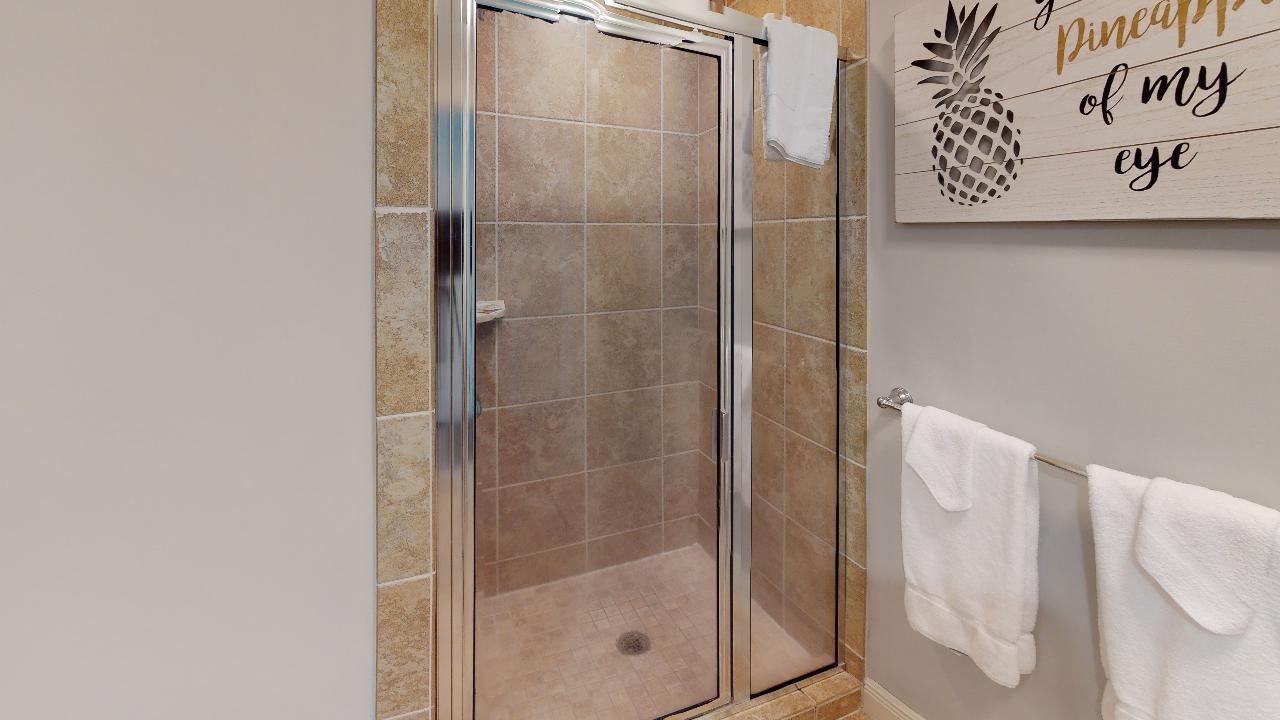 Walk-In Shower with Glass Door.