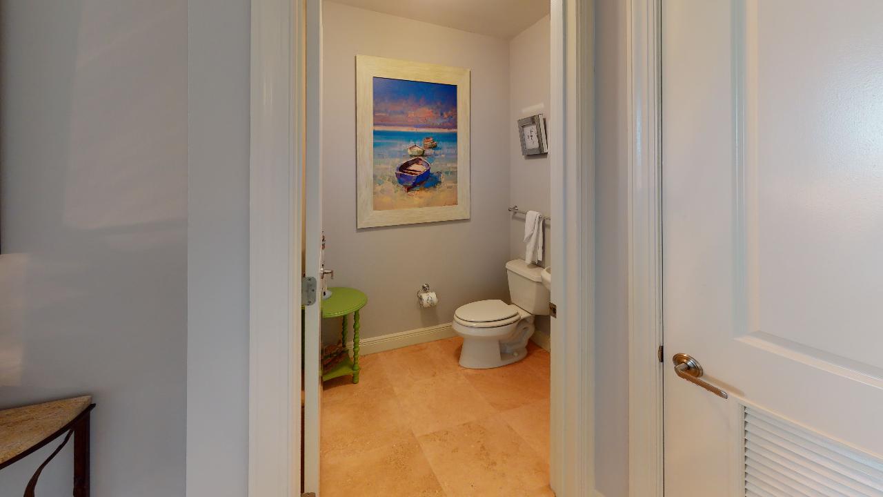 Bathroom Door Open and Toilet.