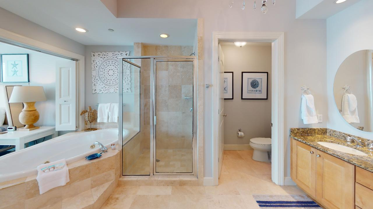Bathroom with Jacuzzi, Walk-In Shower, Toilet, and Double Vanity Sink.