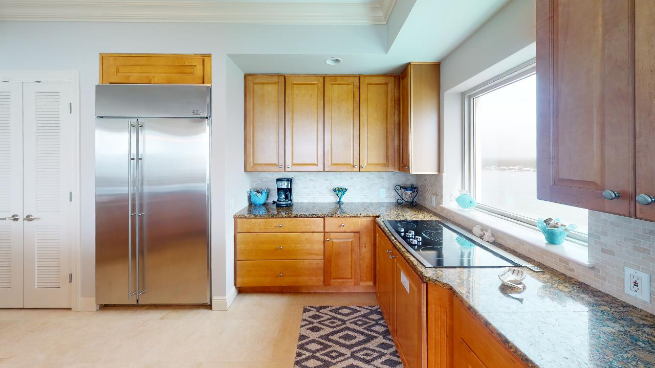 Kitchen, Refrigerator, Coffee Maker, and Pantry Doors.