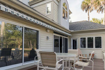 Dine around the table or relax in the Adirondack chairs. A retractable awning shades you from the afternoon sun.