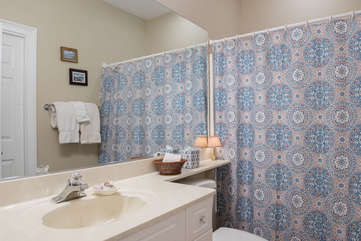 A large bath is in the hall off the twin bedroom.