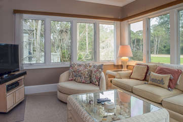 Relax in the sun room that has views of the golf course.