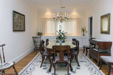 The dining room has a table that seats 8 guests with additional chairs available.