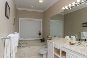 The master bath has a large vanity and soaking tub.