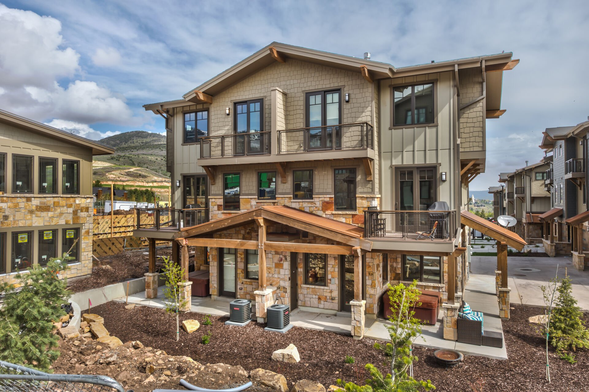 Exterior of Blackstone with 2-Car Garage and Multiple Private Decks