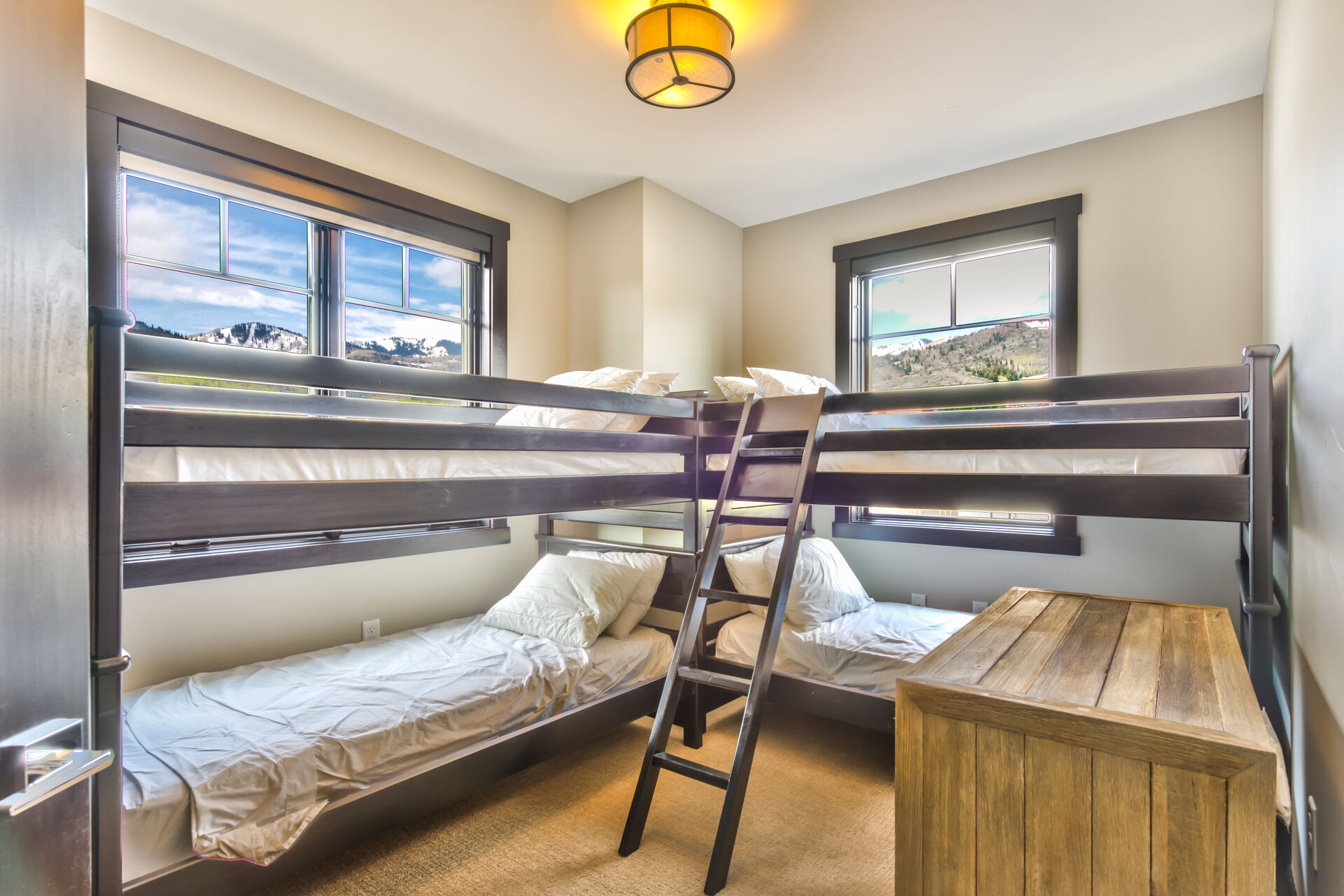 Bedroom 3 is a Bunk Room on the Upper Level with 4 Twin Beds and a Shared Full Bathroom