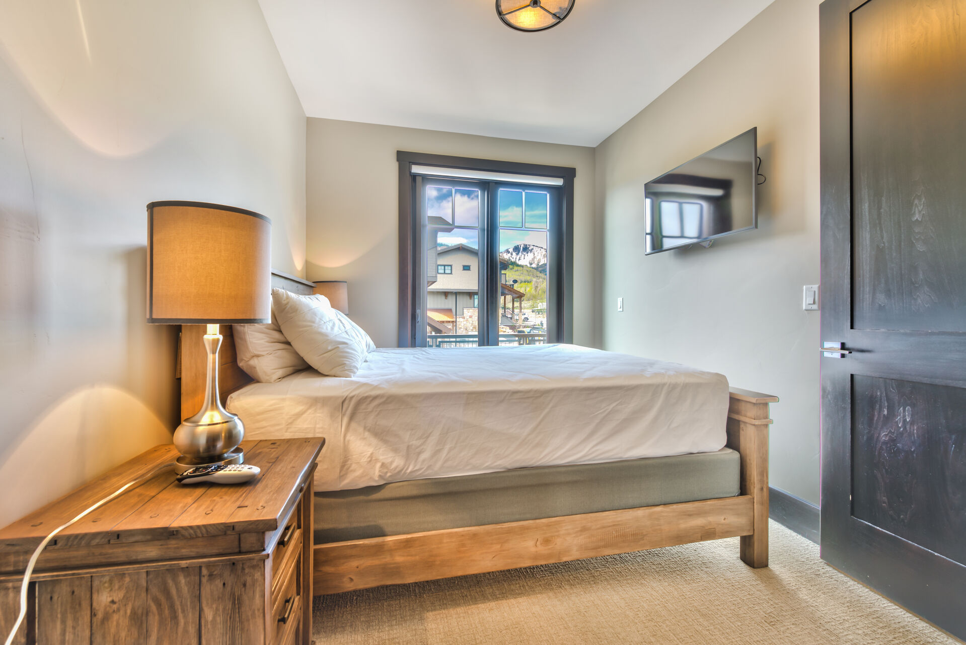 Bedroom 2 on Upper Level with a Queen Bed, 40 inch HD 4K Smart TV/Direct TV, a Private Deck and a Shared Full Bathroom