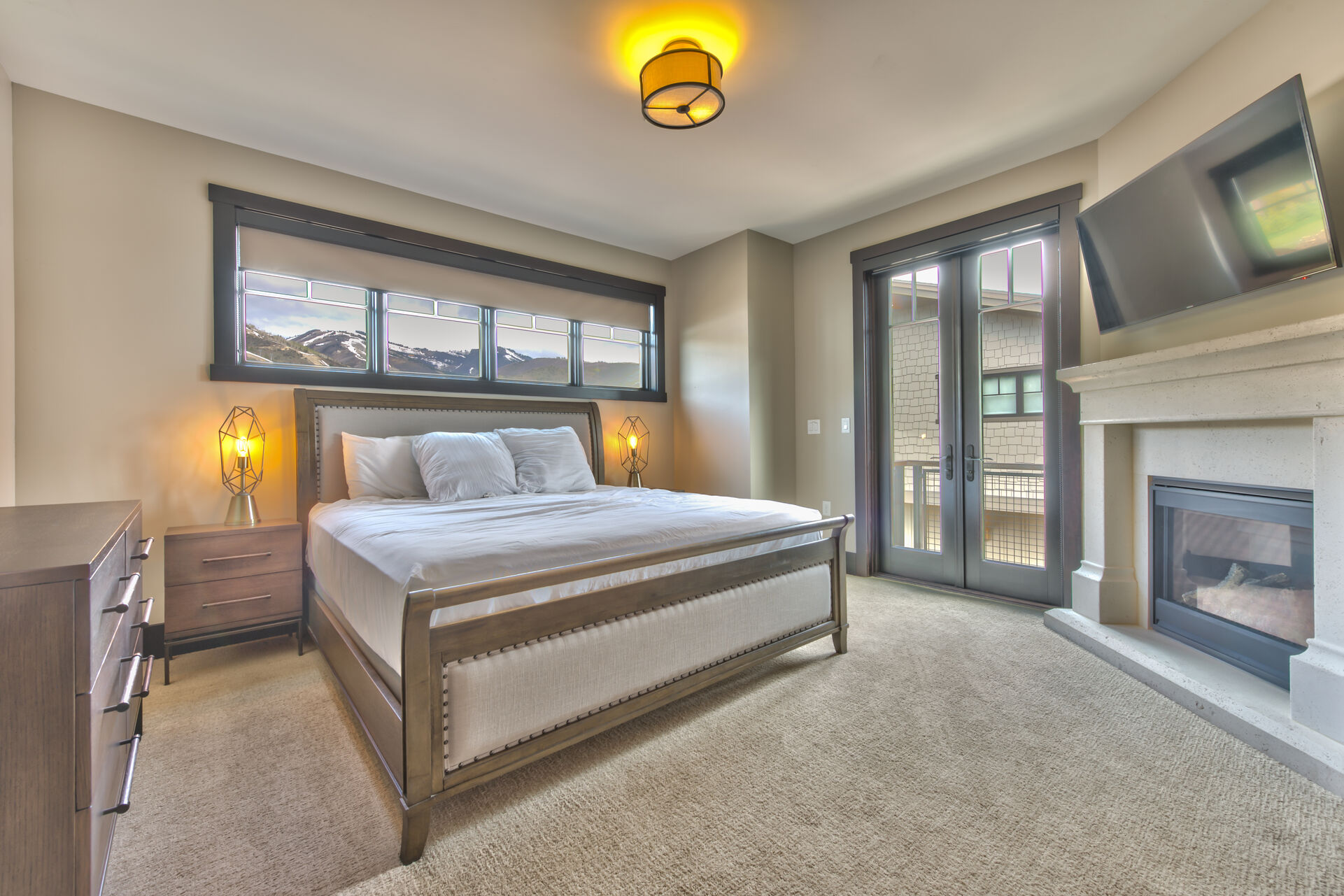 Master Bedroom with King Bed, Private Master Bathroom, 50 inch HD 4K Smart TV/Direct TV, Gas Fireplace, and Private Deck