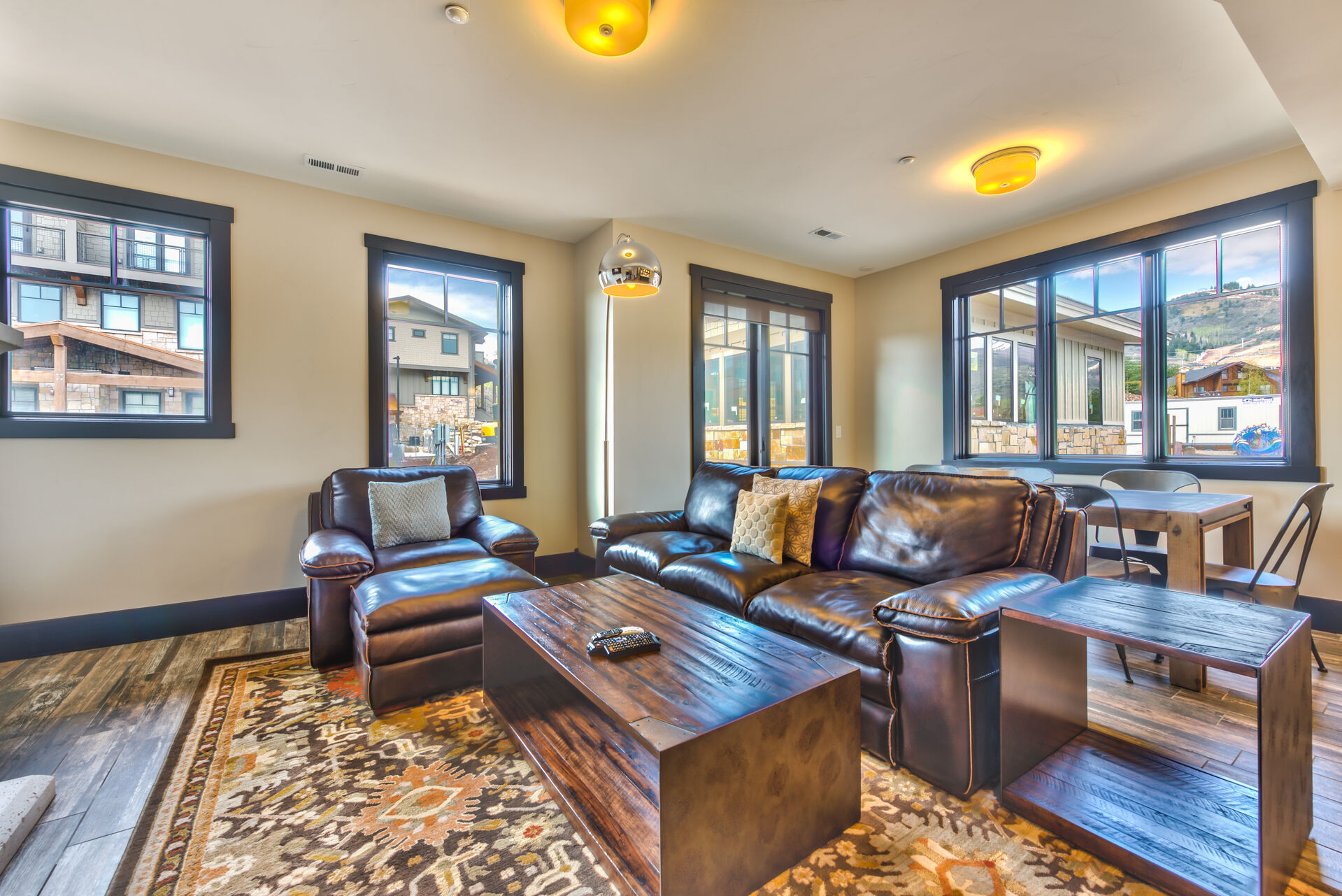 Living Room with a Gas Fireplace, 55 inch HD 4K Smart TV/Direct TV, Private Deck and a Full Bathroom with Heated Floors