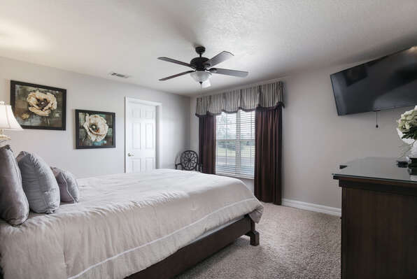 You`ll love relaxing in this elegant downstairs queen bedroom