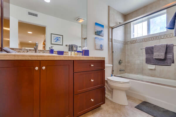 Shared Bathroom Features a Tub/Shower Combo