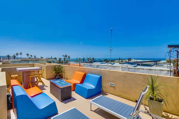 Roof Top Sundeck, Outdoor Fireplace, Lounge Seating and Dining with Ocean Views