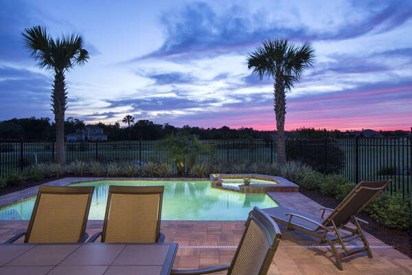 Relax by the pool as the sun sets