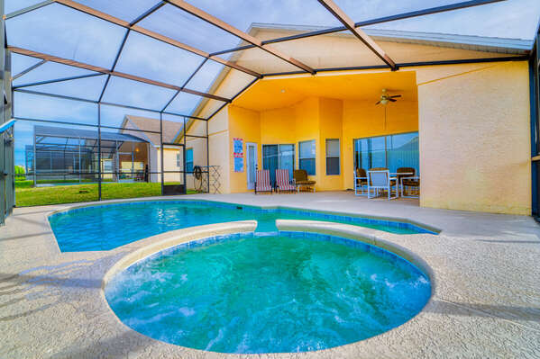 Fully enclosed pool and spa with covered seating area.