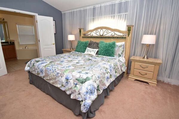Relaxing master bedroom with king bed and en-suite bathroom
