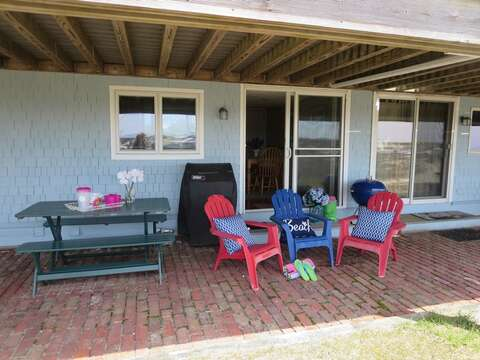 Back patio where you can enjoy grilling on the gas or charcoal grills! - 22 Starfish Lane Chatham Cape Cod - New England Vacation Rentals