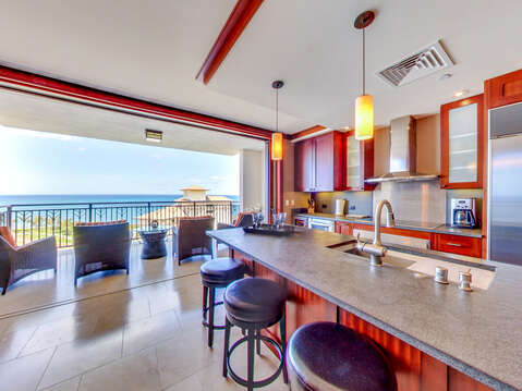Full Kitchen, with Breakfast Bar and a Gorgeous Ocean View inside our Villa