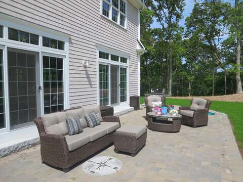 Comfortable and welcoming patio -gas grill-also has large table with 6 chairs and bench for dining- 5 White Cedar Lane -Orleans- Cape Cod New England Vacation Rentals