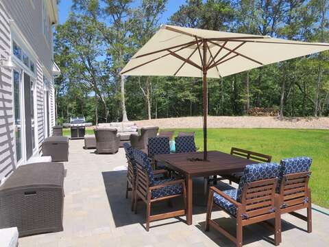 Enjoy the large table with umbrella for outdoor dining! 5 White Cedar Lane -Orleans- Cape Cod New England Vacation Rentals