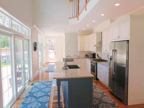 Fully equipped and updated kitchen -granite counter tops-breakfast bar- sliders out to patio- 5 White Cedar Lane -Orleans- Cape Cod New England Vacation Rentals