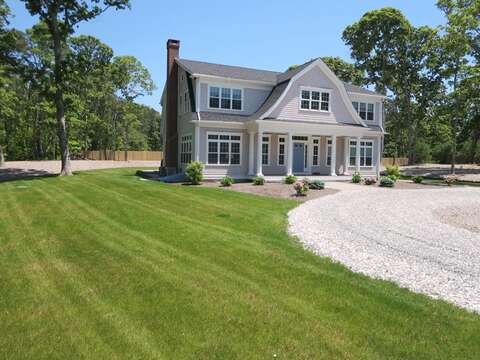 Large circular drive with beautiful lawn on the side that wraps around the back-5 White Cedar Lane -Orleans- Cape Cod New England Vacation Rentals