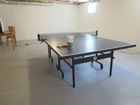 Ping Pong table can be found in the basement- 5 White Cedar Lane -Orleans- Cape Cod New England Vacation Rentals