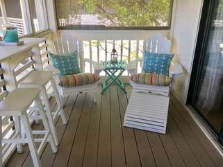 New adirondack chairs complete the screened in porch.