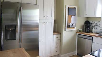 Stainless steel appliances and a pantry are highlights.