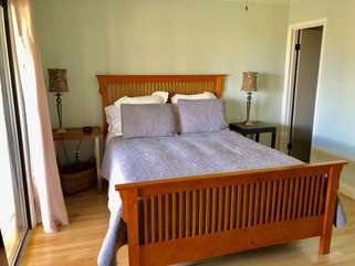 The master bedroom has a queen bed and attached full bath.