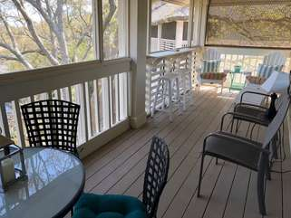 The large screened in porch overlooks the tidal marsh.