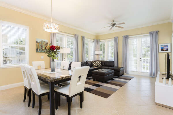 The contemporary living space has tile floors and plenty of gorgeous natural sunlight