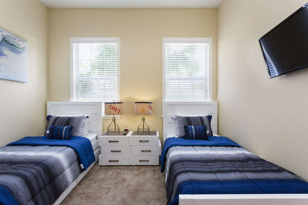 The kids room has two twin beds