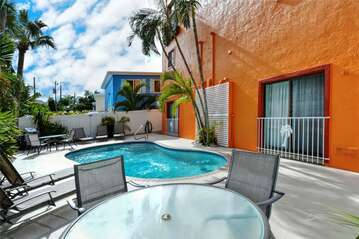 Seaside Villas heated pool with tropical landscaping, gas grills, tables/chairs, loungers...