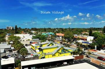 Aerial view of Siesta Village - ideally located on the beach with shops and restaurants in abundance