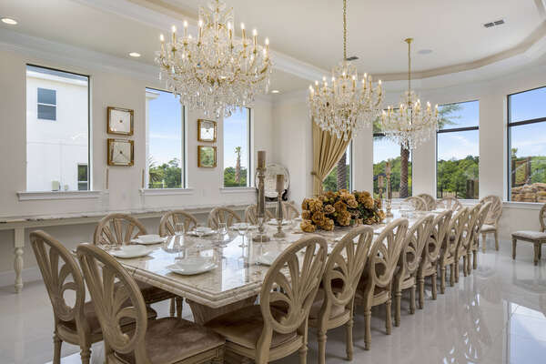 The luxurious dining space has seating space for 24