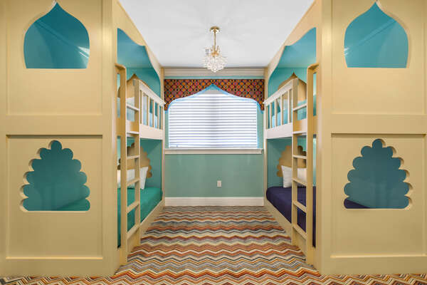 The custom twin over twin bunk beds are the perfect sleeping arrangements for the kids